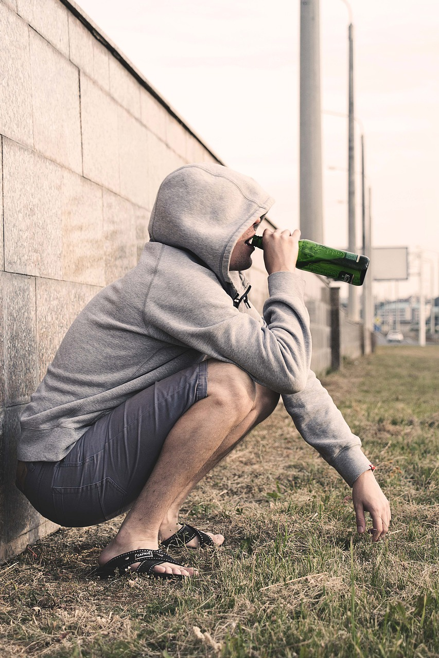 man drinking from beer bottle